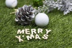 Golf ball Merry X`mas sign on green grass