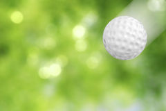 Golf ball in motion royalty free stock images