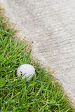 Golf ball near the cart path Royalty Free Stock Photo