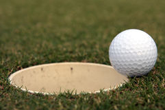 Golf Ball near the cup Stock Photography