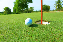 Golf ball near hold Royalty Free Stock Photography