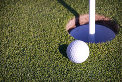 Free Golf Ball Near Hole Stock Images - 17717734