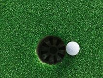 Golf ball near the hole Stock Photography