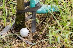 Golf ball near the tab water pipe. Close up dirty Golf ball near the tab water pipe Royalty Free Stock Photos