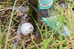 Golf ball near the tab water pipe. Close up dirty Golf ball near the tab water pipe Royalty Free Stock Images