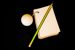 Golf ball with notebook score card Royalty Free Stock Images