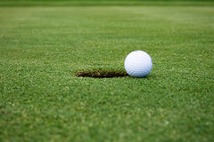 Golf Ball On The Way To The Hole Royalty Free Stock Photo