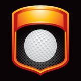 Golf ball in orange display Royalty Free Stock Photography