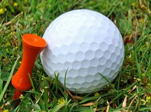 Golf Ball & Orange Tee Royalty Free Stock Photography