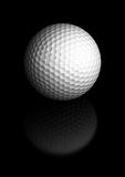 Golf ball over black background Royalty Free Stock Photos