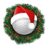 Golf ball over evergreen holiday wreath Royalty Free Stock Images