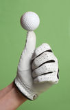 Golf ball over thumb Royalty Free Stock Images