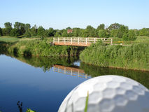 Golf ball overlooking course Royalty Free Stock Image