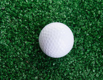 Golf ball ower green grass Royalty Free Stock Images