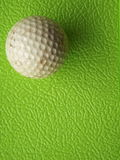 Golf ball past usage. On rough green background Stock Photo