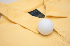 Golf Ball and Polo Shirt Stock Images