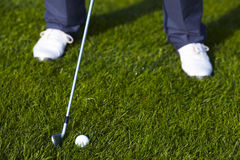 Golf ball position before the swing. Front Royalty Free Stock Photography