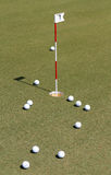 Golf ball on practice green. Royalty Free Stock Photography