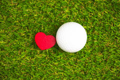 Golf ball and putter on green course Stock Image