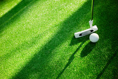 Golf ball with putter on green course. Selective focus. Golf ball with putter on green course. Image with selective focus Royalty Free Stock Image