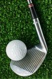 Golf Ball and putter on green grass Stock Photos