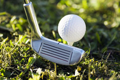 Golf ball and putter Stock Images