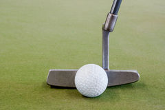 Golf ball with putter Stock Image