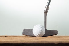 Golf ball and putter Royalty Free Stock Photos