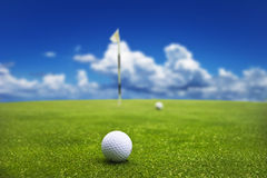 Golf ball on putting green Royalty Free Stock Image