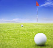 Golf ball on putting green Royalty Free Stock Images