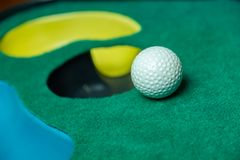 Golf ball on putting mat royalty free stock photo