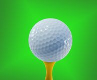 Golf ball ready for hitting. A golf ball stands ready on its tee royalty free stock photo