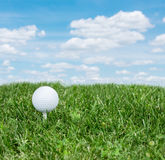 Golf ball. Golf ball ready to be hit on the green grass Royalty Free Stock Photography