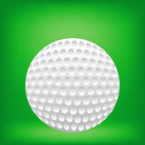Golf ball. Realistic golf ball on green background. Traditional white golf ball with clipping path Royalty Free Stock Images