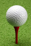 Golf ball on red tee. Macro shot of golf ball on red tee on the golf course Stock Photography