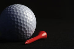 Golf ball with red tee Stock Photo
