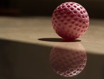 Golf ball reflection and shadow Royalty Free Stock Image