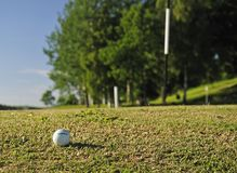 Golf ball on the right way Royalty Free Stock Photo