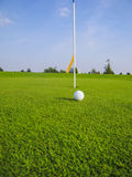 Golf ball near the hole Stock Photo
