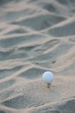 Golf ball in the sand Royalty Free Stock Photos