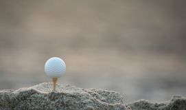 Golf ball in the sand. Golf ball with dimple in the sand Stock Photos