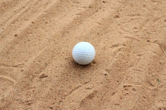 Golf ball on sand Royalty Free Stock Image