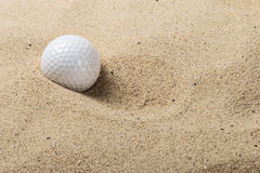 Golf ball on the sand Stock Photography