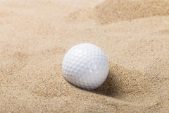 Golf ball on the sand Royalty Free Stock Photography