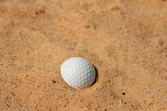 golf ball in sand on bunker Royalty Free Stock Photo