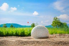 Golf ball on sand bunker in golf courses. Close up Golf ball on sand bunker in golf courses Royalty Free Stock Photos
