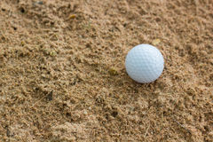 Golf ball in sand bunker Royalty Free Stock Photos
