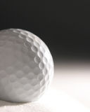 Golf ball in sand dune Stock Photos