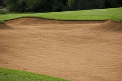 Golf Ball in the Sand Trap Stock Image