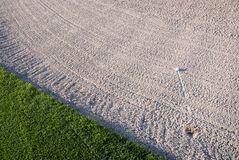 Golf Ball in Sand Trap Royalty Free Stock Image
